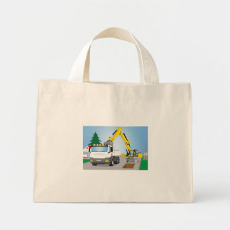 Road site with white truck and yellow excavator mini tote bag