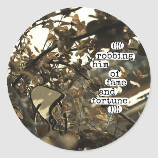 robbing him of fame and fortune round sticker