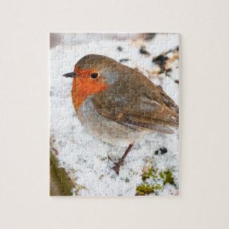 Robin on a snowy log jigsaw puzzle