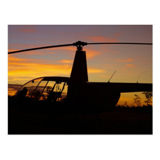 Robinson R44 helicopter at sunset Postcard