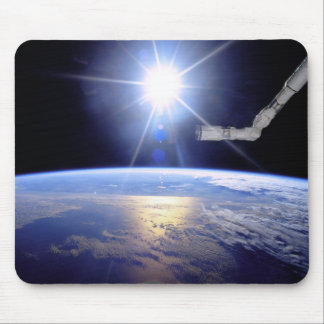 Robot Arm Over Earth with Sunburst Mouse Pad