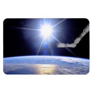 Robot Arm Over Earth with Sunburst Rectangular Photo Magnet