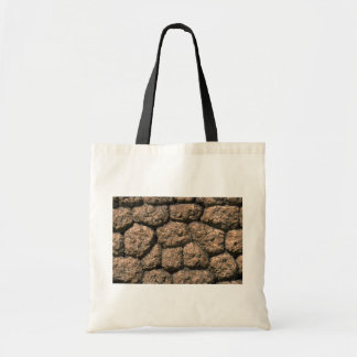 Rock fence close-up bags