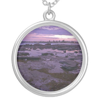 Rockpools at sunset round pendant necklace