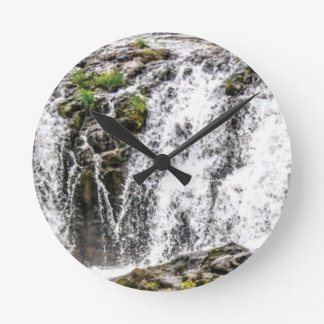 rocks fall over the falls round clock