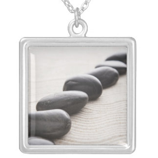 Rocks on sand square pendant necklace
