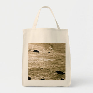 ROCKY SHORE AND WAVES IN SEPIA CANVAS BAG