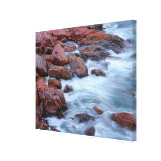 Rocky shoreline with water, Canada Canvas Print