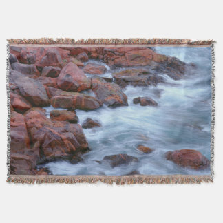 Rocky shoreline with water, Canada Throw Blanket