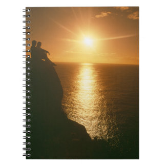 romantic sunset by the beach spiral note book