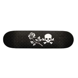 Rose and skull on black skateboard deck