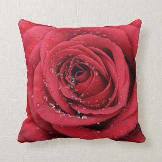 Rose covered in water droplets throw pillow