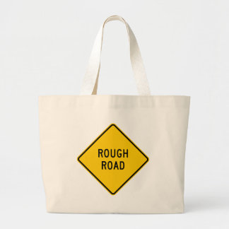 Rough Road Highway Sign Tote Bags