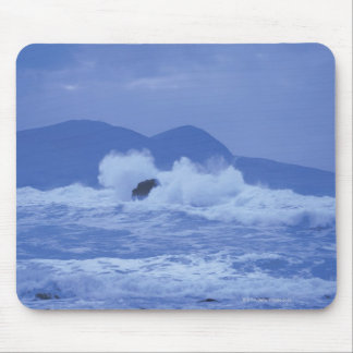 rough seas crashing against a rocky shore mouse pad