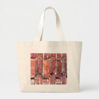 Rough wall of Bricks Tote Bags