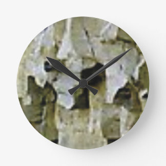 rough white rock ceiling round clock
