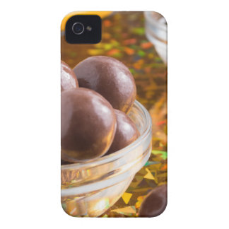 Round candy chocolate close-up on a colorful iPhone 4 cover