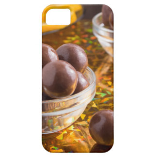 Round candy chocolate close-up on a colorful iPhone 5 covers