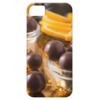 Round candy  from chocolate close-up on a colorful iPhone 5 covers