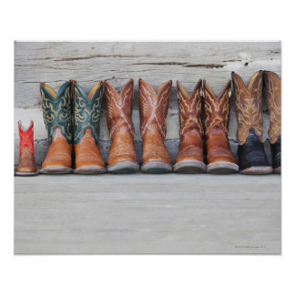 Row of cowboy boot on porch of log cabin posters