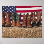 Row of cowboy boots on haystack