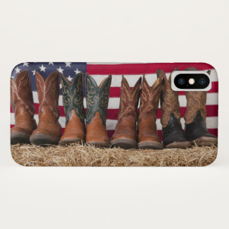 Row of cowboy boots on haystack iPhone x case