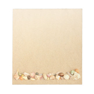 Row of Seashells on Beach Sand Notepad