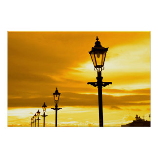 row of vintage lamps at sunset poster