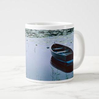 Rowboat on small lake surrounded by water jumbo mug