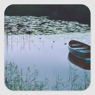 Rowboat on small lake surrounded by water square sticker