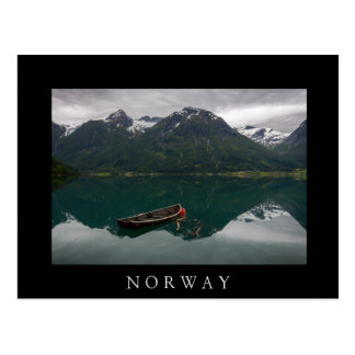 Rowboat with mountains reflection in Norway Postcard