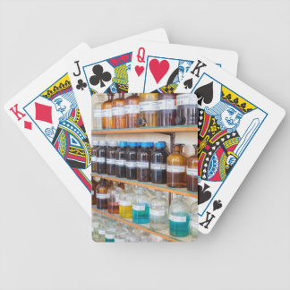 Rows of fluid chemicals in bottles at chemistry bicycle playing cards