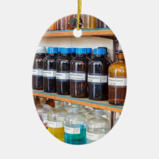 Rows of fluid chemicals in bottles at chemistry ceramic ornament