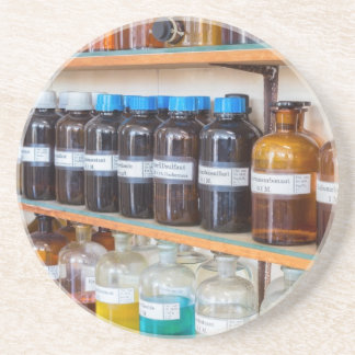 Rows of fluid chemicals in bottles at chemistry coaster