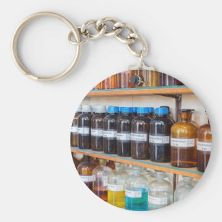 Rows of fluid chemicals in bottles at chemistry key ring