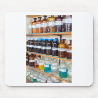 Rows of fluid chemicals in bottles at chemistry mouse pad
