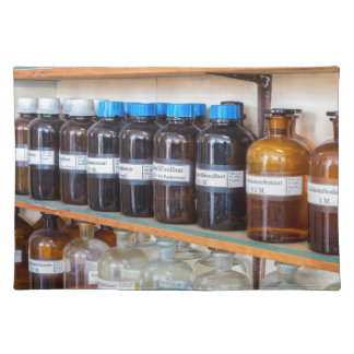 Rows of fluid chemicals in bottles at chemistry placemat