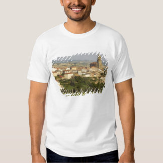 Rows of grape vines in the foreground frame the tee shirts
