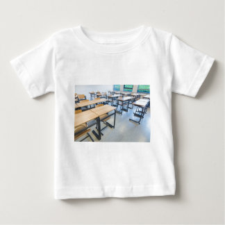 Rows of tables and chairs in classroom baby T-Shirt