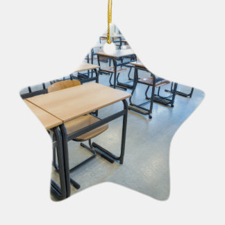 Rows of tables and chairs in classroom ceramic ornament