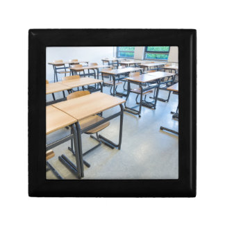 Rows of tables and chairs in classroom gift box