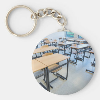 Rows of tables and chairs in classroom key ring