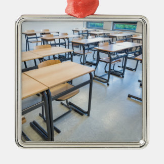 Rows of tables and chairs in classroom metal ornament