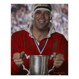 Rugby player holding trophy cup, portrait poster