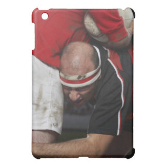 Rugby player tacking opponent, mid section iPad mini covers