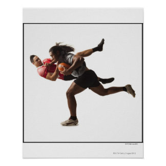 Rugby players tackling for ball poster