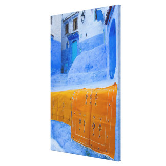 Rugs Draped On A Blue Wall Canvas Print
