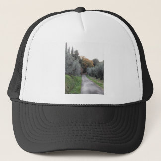 Rural landscape with asphalt road in the autumn trucker hat