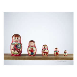 Russian dolls on a shelf. postcard
