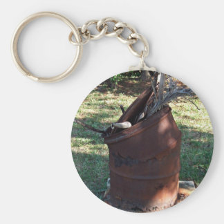 Rusted garbage can in grassy landscape basic round button key ring